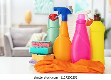 Set of cleaning supplies on table indoors