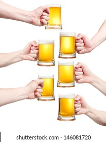Set, closeup of a male hand holding up a glass of beer over a white background
