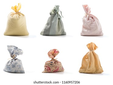 Set of cloth Fabric drawstring sack isolated on white background. Clipping path included.