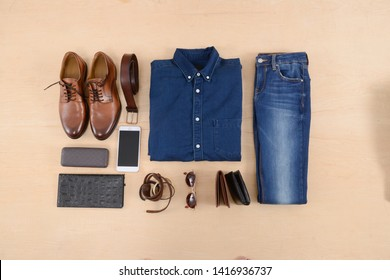 Set of clothes and various accessories for men on wooden background