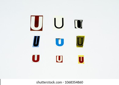 Set of collection colorful newspaper cut out letters as ornaments or design elements. Isolated on white background. Letter U.