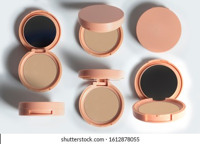 set collection group of beauty fashion makeup color professional powder cushion foundation bb cream compact with plastic round case container packaging on white background