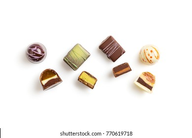 Set of coloful luxury handmade bonbons on white background. Exclusive handcrafted chocolate candies. Product concept for chocolatier