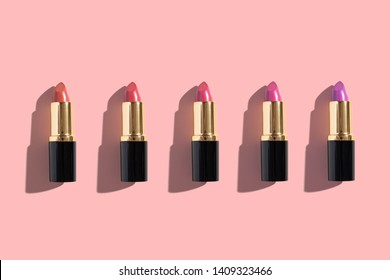 Set of color lipsticks on color background. Professional decorative cosmetics, promotional product pomade for advertising. Flat lay, top view, minimalism
