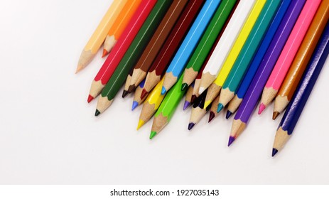 Set of color pencil on white background, top view