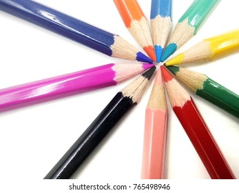 A set of color pencils isolated on white background, empty space for text. Selective focus