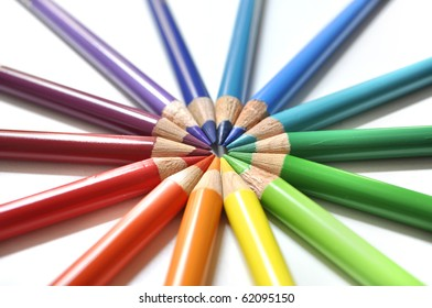 Set of color pencils positioned in the shape of a circle rainbow.