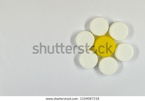 set of colored caps isolated on white background forming a daisy