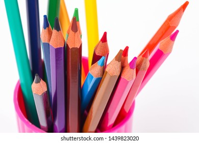 set of colored pencils on a white background