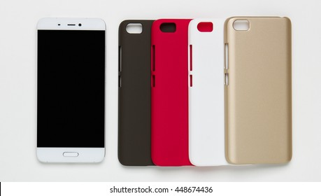 Set of colored plastic covers for mobile phone on a white background