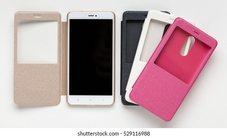 Set of colored plastic protective case  for smartphone with a window, isolated on a white background