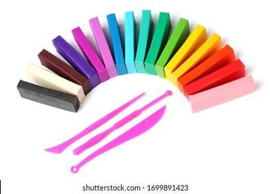 Set of colored plasticine for childrens home creativity close-up, top view, flat lay, isolate, copy space, white background.