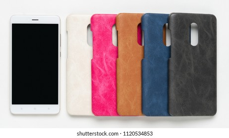 Set of colored silicone back covers for smartphone on white background