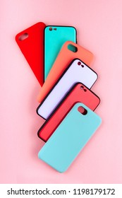 Set of colored silicone covers for smart phone on a colorful background