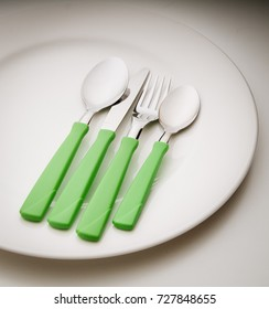 Set of colored silverware, fork, knife, spoons.