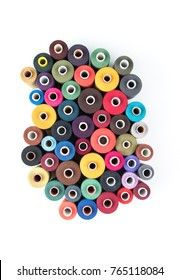 Set of colored thread coils on white background, sewing and tailoring