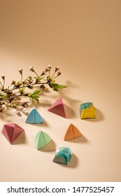 Set of colorful chocolate candies and cherry branch