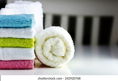 Set of colorful clean towels on the table.