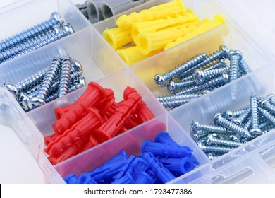Set of colorful dowel, screw, fastener. A box with dowel, bolt and screw. Set of building tools. - Shutterstock ID 1793477386