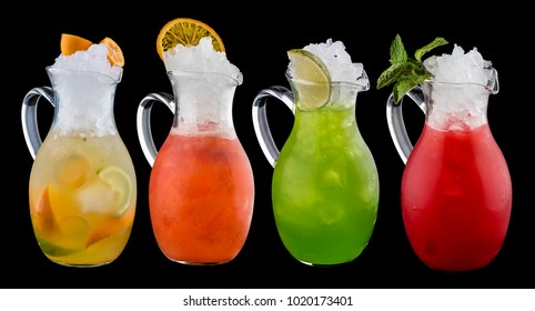 Set of colorful lemonades in jugs. On dark background