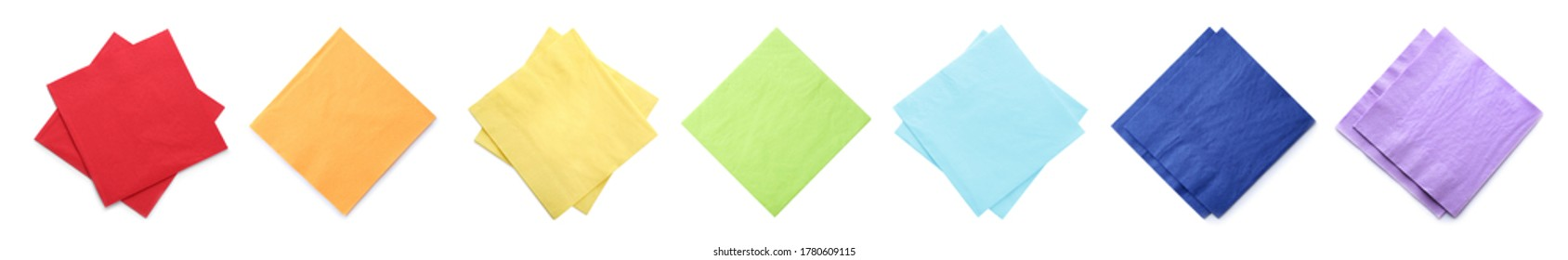 Set with colorful paper napkins on white background, top view. Banner design