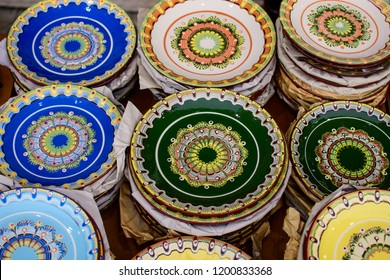 Set of colorful plates painted in traditional Balkan (Bulgarian) ornaments