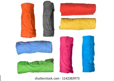 Set of colorful rolled clothes isolated over white background