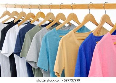 Set of colorful shirt clothing on hanging on white background