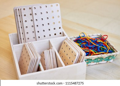 Set of colorful strings and wooden shapes