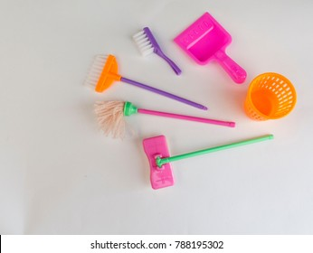Set of colorful toys for the cleaning of the doll house