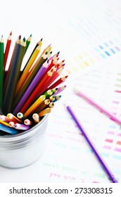 Set of colorful wooden pencils and color palette