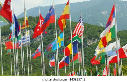 set of coloured flags of many nations of the world that waving all along
