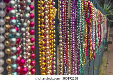 Set of colourful beads on a fence for Mardi Gras,New Orleans, Louisiana, USA. Carnival time.
