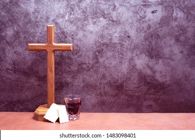 Set for Communion or the Lords Supper a Christian Remembrance of Jesus Christs Death and cross wood on the floor for inspiration and background