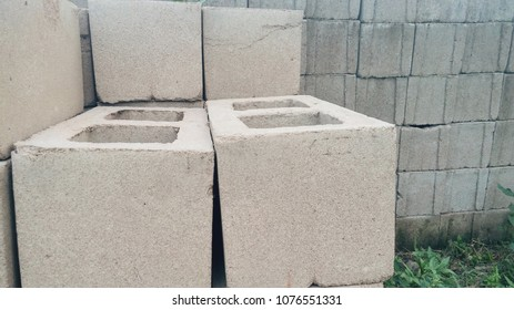 Set of concrete blocks on a green grass