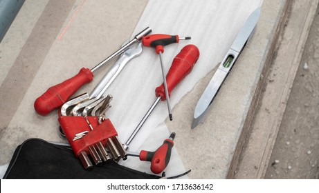 Set of construction tools. allen key set, screwdriver. spirit level. tool tools on the floor