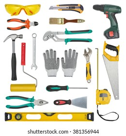 Set of construction tools isolated on a white background. Level, saw, glasses, tape measure, wrench, spanner, paint roll, hammer, cutter, pliers.
