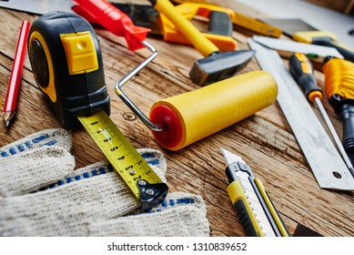 set of construction tools on a wooden background