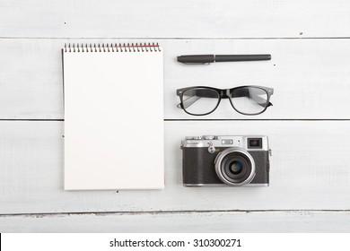 set of cool stuff on wooden desk