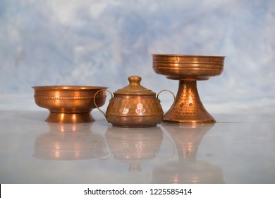 set of copper  antique object and candelabra