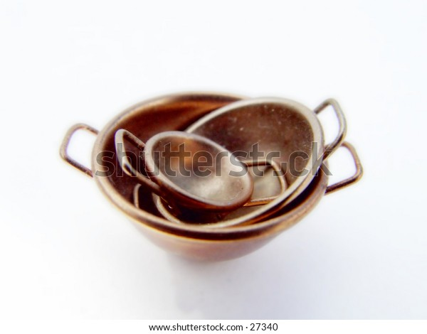 Set of copper cooking bowls, isolated on white background