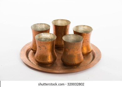 Set of copper cups on salver