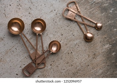 A set of copper measuring spoons