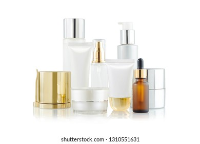 Set of cosmetic containers. Cosmetic product bottles, dispensers, droppers, jars and tubes isolated on white
