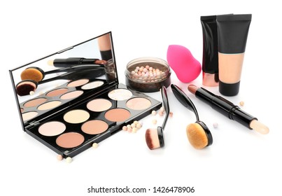 Set of cosmetics for contouring makeup on white background