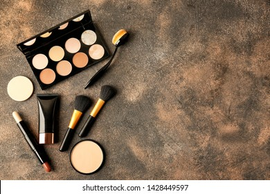 Set of cosmetics for contouring makeup on grey background
