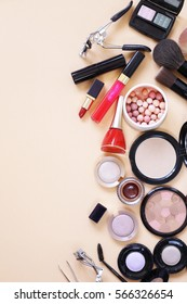 Set cosmetics - makeup brushes, eye shadow, powder, lipstick, nail polish.