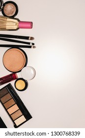 Set of cosmetics, makeup tools and accessories on a white background with copy space for text. View from above.