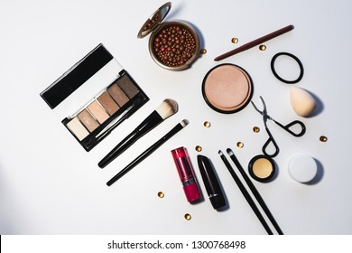Set of cosmetics, makeup tools and accessories on a white background. View from above.