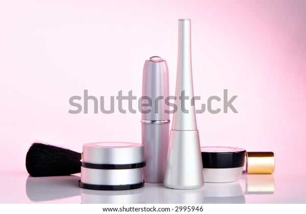 Set of cosmetics on pink background